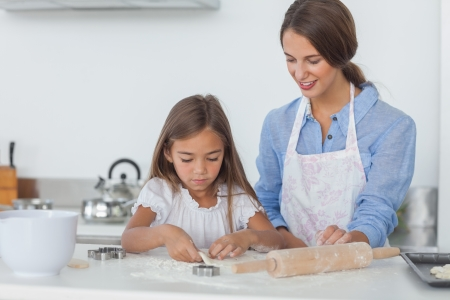 Mother and daughter baking together in the kitchen photo