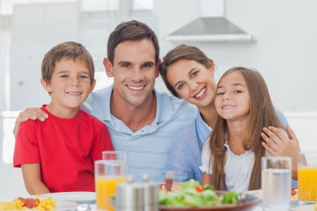 Portrait of a cute family at the table Stock Photo - 20639737