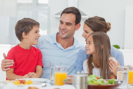 sitting at table: Happy family during the dinner at home at the table Stock Photo