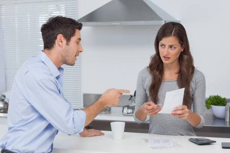 Couple doing their accounts in the kitchen Stock Photo - 20637982