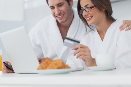 Couple purchasing online while having breakfast Stock Photo - 20624296