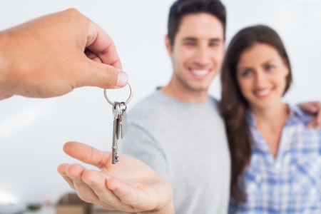 real people: Man with his wife being given a house key