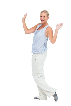 hands raised: Woman looking at camera with hands raised on white background