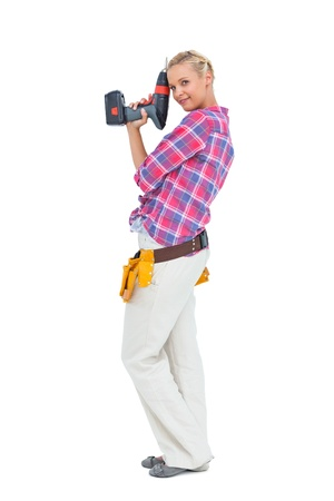 power drill: Woman standing with a power drill against white background