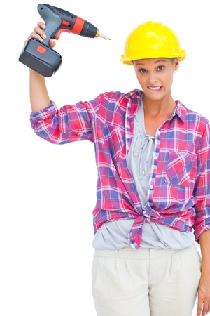 power drill: Attractive handy woman holding a power drill on white background