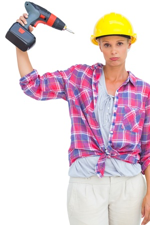 Blonde handy woman holding a power drill on white background  photo