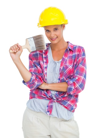 Beautiful handy woman holding a brush on white background  photo