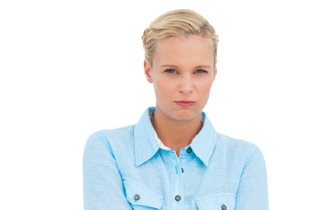 Furious blonde looking at camera on white background