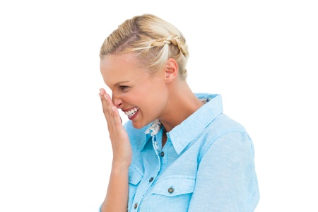 giggling: Attractive blonde giggling on white background Stock Photo