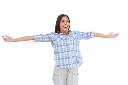 Young woman standing with her arms open on white background photo