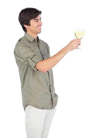 Happy young man with wine glass looking to the right photo