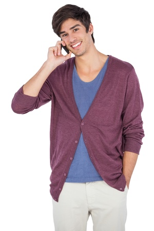 chinos: Smiling man speaking on the phone on a white background Stock Photo