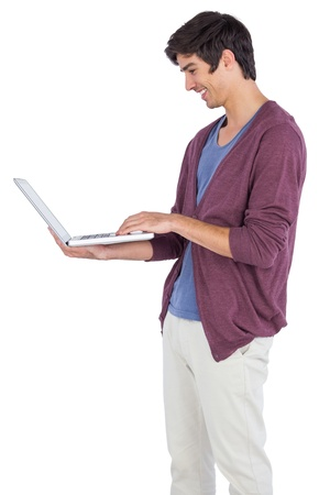 chinos: Man holding a laptop on a white background