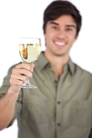 white wine glass: Man holding white wine glass on a white background