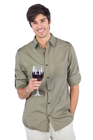 Handsome man with wine glass on a white background photo