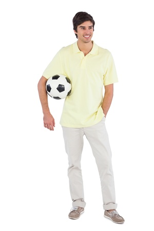 Happy man holding soccer ball on a white background photo