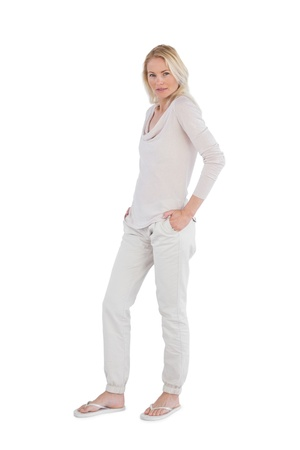 Blonde woman posing for the camera on a white background photo