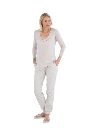 Peaceful woman with hands in pockets on a white background photo