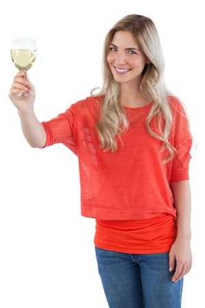 white wine glass: Smiling woman holding white wine glass on a white background