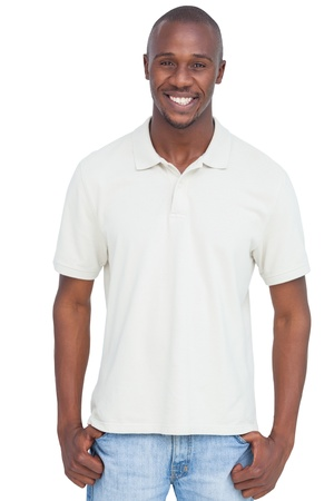 Smiling man with thumbs in pocket on a white background photo