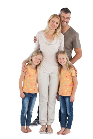 Happy family smiling at the camera on a white background photo