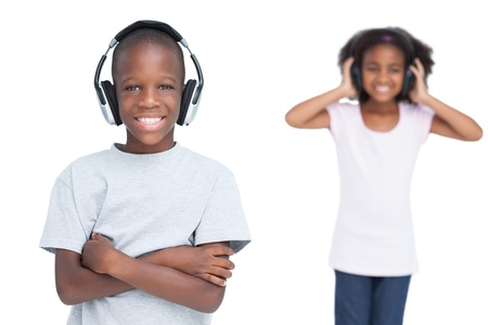 Kids listening to music with headphones on a white background photo