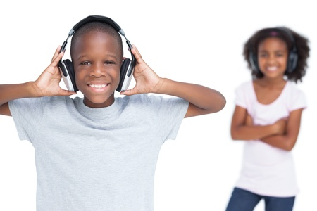 Brother and sister listening to music on a white background photo