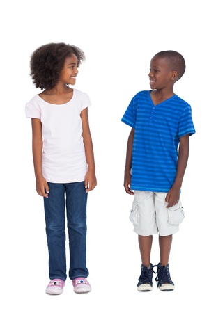 Cute kids looking at each other on a white background Фото со стока