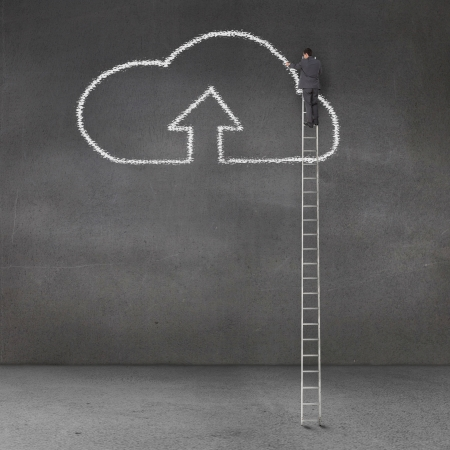 could: Rear view of a businessman standing on a giant ladder and drawing the cloud computing symbol Stock Photo