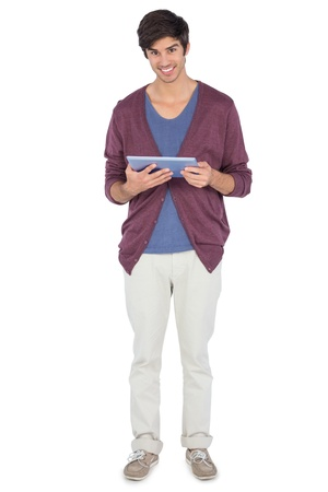 chinos: Smiling man with tablet pc looking at the camera
