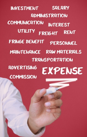 fringe benefit: Businessman writing expense terms on red background