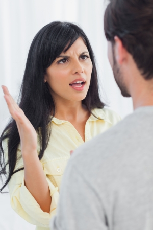 Woman about to slap her boyfriend during fight at home photo