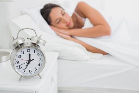 deeply: Pretty woman sleeping deeply in bed