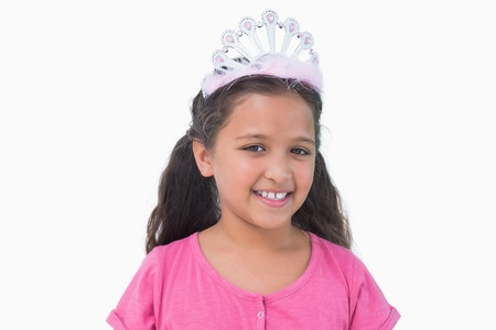 Little girl wearing tiara for a party on white background photo