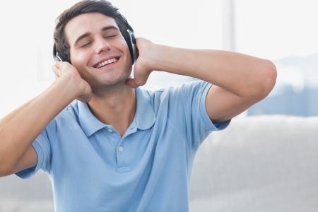 Man enjoying music with headphones photo