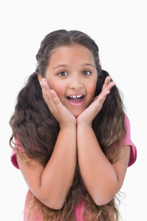 Surprised little girl on white background photo