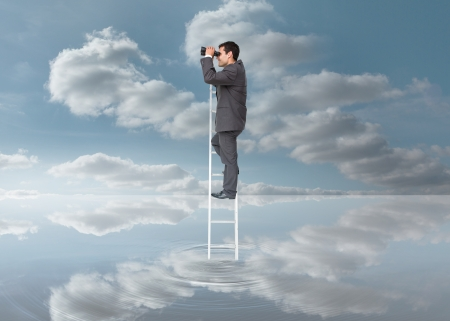 vision future: Elegant businessman standing on ladder with binoculars over a puddle on blue sky background