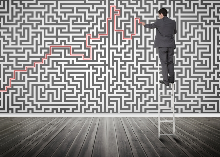 resolving: Businessman standing on a ladder solving maze puzzle in an empty room