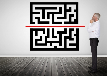 Thoughtful businessman looking at qr code on a wall