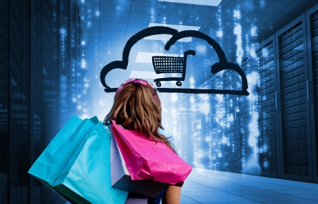 Woman in a data center holding shopping bags and looking at a drawing with a shopping cart into a cloud photo
