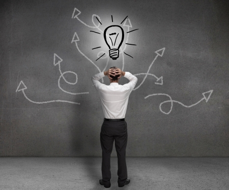 Stressed businessman looking at a light bulb drawn on a light bulb  photo