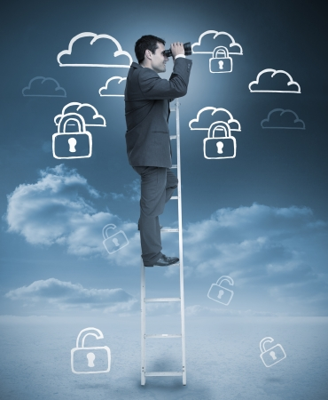 Businessman standing on ladder with drawings of clouds on the background photo