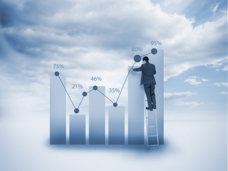 Businessman on a ladder drawing a chart with blue sky on the background Stock Photo - 20624333