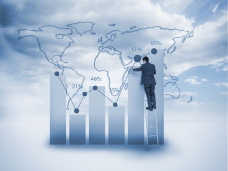 information international: Businessman standing on a ladder and drawing a chart with a world map on the background