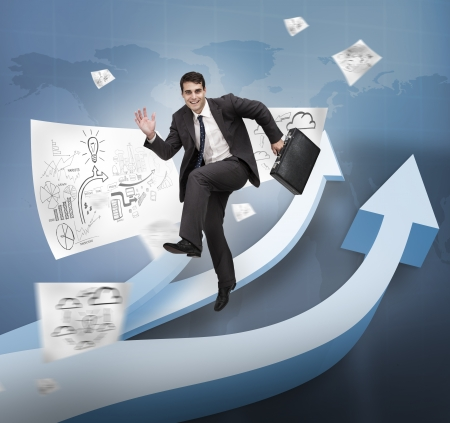 Businessman jumping over arrows and drawings photo