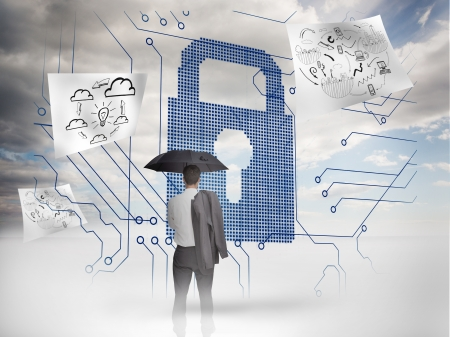 Businessman under an umbrella looking at a giant padlock with drawings floating around photo