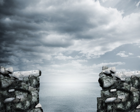 leading: Cliffs leading out to the sea under a grey sky Stock Photo
