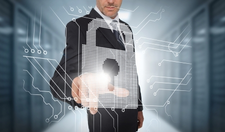 Businessman selecting a futuristic padlock with a data center on the background photo