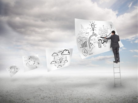 Businessman on a ladder drawing on a floating paper with blue sky on the background photo
