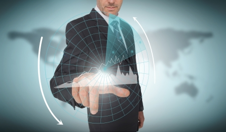 Businessman selecting a futuristic interface with a world map on the background photo